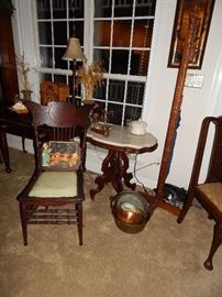 Marble top side table (one of many). Copper pots.