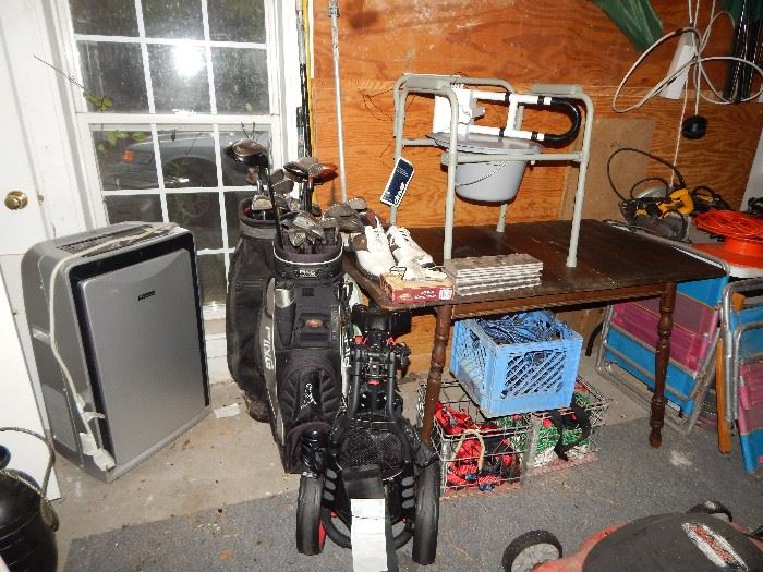 Air Conditioner  $250, Golf Clubs, wooden table, etc.