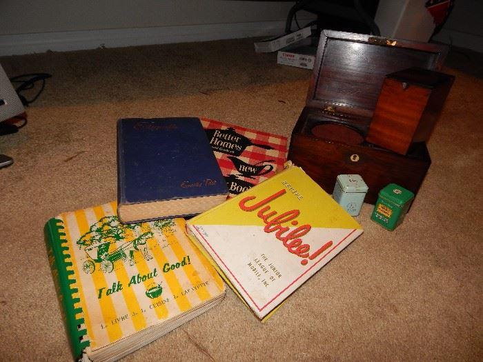 vintage cookbooks. vintage Emily Post Etiquette book. Tea box antique?