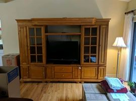 """Measurements are 42"""" wide by 36"""" high is the opening for TV.. Overall the unit is 110"""" wide by 24"""" deep by 80"""" high.. Free delivery on this item locally. Extremely nice 3pc 9 Foot lighted TV Wall Unit and Entertainment Center. Each end unit has glass shelving behind glass doors. There are tons of storage in drawers and doors. The center overhead canopy is also expandable. It's like new!"""