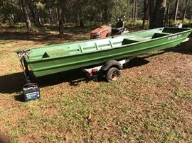 boat with trailer, trolling motor and battery.