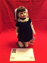 Collectible and porcelain dolls
