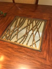 Glass/mirror/brass accent inlay on the table top