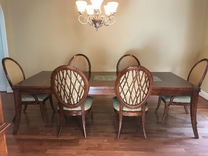 """Table measures 9' (with one leaf in) by 4' wide and 6'6"""" long without a leaf"""