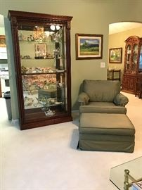 Beautiful Display Cabinet.  Front of Cabinet slides both directions.   Chair and ottoman, Artwork