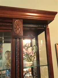 Curio Cabinet slides both directions.  Lighted.