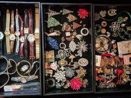 Watches, pins, religious and Irish pendants.