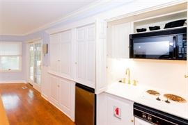 Wet bar/mini kitchen; custom cabinetry throughout