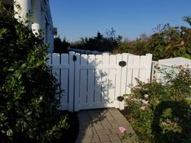 Vinyl gates and small amount of fencing