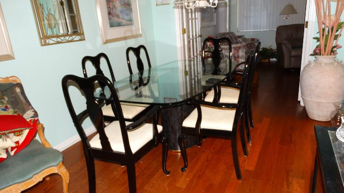 MODERN  GREEN ITALIAN TRAVERTINE MARBLE BASE GLASS TOP DINING TABLE WITH SIX EBONY CHAIRS. TWO ARMED CHAIRS AND FOUR SIDE CHAIRS. LARGE TERRACOTTA POTTERY DECOR FLOOR VASE.