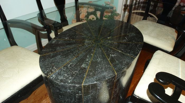 CLOSE UP OF TRAVERTINE MARBLE PEDESTAL FOR DINING TABLE