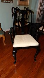 CLOSE UP OF EBONY FRAME ECRU UPHOLSTERED SEAT DINING CHAIR