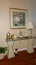PAIR OF HOUR GLASS PLASTER PEDESTALS WITH GLASS TOP CONSOLE TABLE AND QUARTZ CLOCKS.