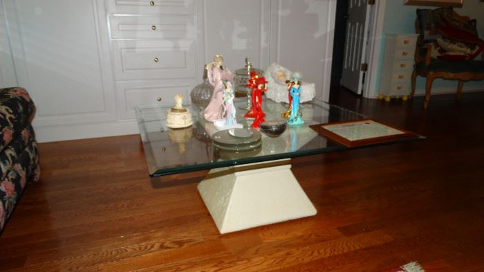 HOUR GLASS PLASTER BASE COFFEE TABLE WITH GLASS TOP.