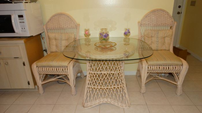 WICKER KITCHEN SET. WICKER PEDESTAL WITH TWO WICKER ARCHED BACK CHAIRS.