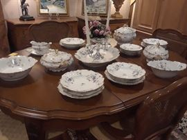 Limoges dinnerware with violet design. Priced to clear. French Provencal dining set reduced 50% to close estate. Chests in background reduced 50% to close estate.