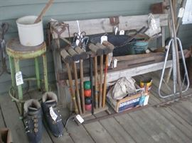 Stuff the ski boots with greens! Crock, metal stool, croquet et, minnow bucket, coal shovel & bucket, ice tongs, levels, wood rake.
