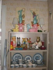 Assortment of chalkware animals, pottery kids, wall plaques, pair pottery lamps, Currier & Ives dishes.