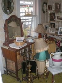 Table top mirror, wood typewriter stand, bowl & pitcher, lamp shades, fireplace tools, adrions and wood carrier, old photos.