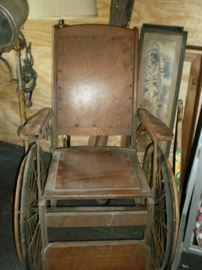 Vintage wooden and metal wheel chair.  In good condition with repair needed on the metal rim of one wheel.