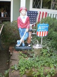 3-1/2 foot concrete golfer.  Unusual statue to welcome guests.