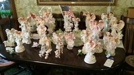 Collection of Seraphim angels, including The Pond and four of the monthly angels with pedestals and porcelain flowers.