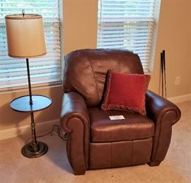 Brown leather chair, floor lamp