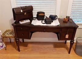 computer desk, accessories, cameras