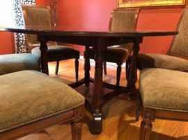 """Ethan Allen 60"""" Round Mahogany Table with 2 additional leaves and 8 side chairs"""