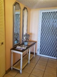 Entry table with glass inserts and 2 matching wall mirrors.