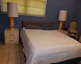Queen bed, 2 matching bedside tables and lamps.