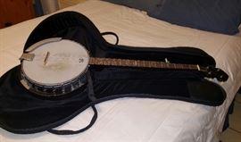 4 string Abilene banjo with cloth case.