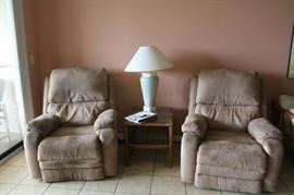 2 matching upholstered electrically assisted recliners