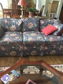 One of two matching couches with coffee table and rug.