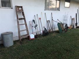 Wood step ladder, gardening tools, wheel barrow