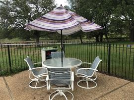 Poolside table, chairs and umbrella