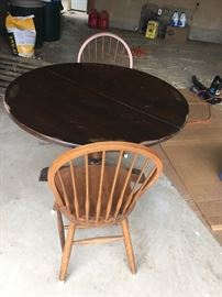 Round table with two wood chairs