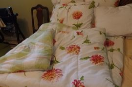 This quilt has matching pillows and bed skirt.