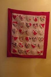 Handmade vintage hearts on handmade quilt