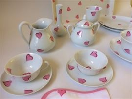 Porthault breakfast set includes 26 pieces: 2 cappuccino cups w/2 saucers, milk jug, egg holder, jam jar w/lid and saucer, sugar bowl w/lid, 2 plates, 2 napkins, heart shaped butter dish, coffee pot w/lid, tray, single flower vase, 2 forks, 2 egg shaped slat share knives, 1 butter knife.  The set was designed by Madeleine Porthault and executed by Limoges porcelain factory.