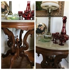 antique  oval marble top table with lamp and collectibles