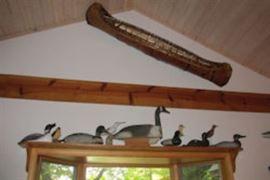 canoe carved birds
