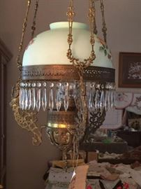Beautiful kerosene brass and crystal prisms. Painted globe. Adjustable height for cleaning and refill.