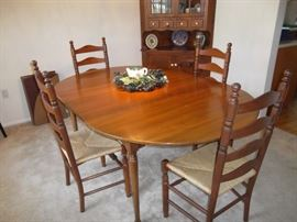 $375.00 Statton? Centennial cherry drop leaf extension dining table with 6 rush seat ladder back chairs