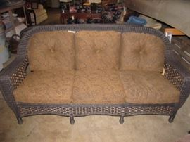 One of 2 matching wicker sofas