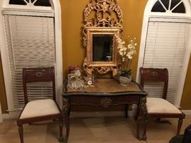 French Writing Desk with Velvet Top. Wood side chairs with face medallion.  Gilt Mirror.  Seth Thomas, Waterford, and Skagen Clocks