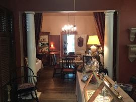 Looking at the dining room and part of the front counter