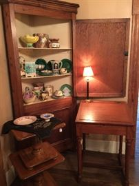 This antique corner cupboard is a wonderful looking piece with lots of storage.  The Majolica is fabulous.  The School Masters Desk is a great antique piece.  The two small tables are Mid-Century