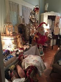 Still the Shabby Room, silver lighted Christmas Tree, lots of vintage Christmas, Old soft toys, vintage baby blankets and clothes, a painted wardrobe, baby cradle, old Victorian wicker