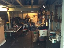 This is the garage full of vintage tools, garden tools a great old lantern collection and lots more